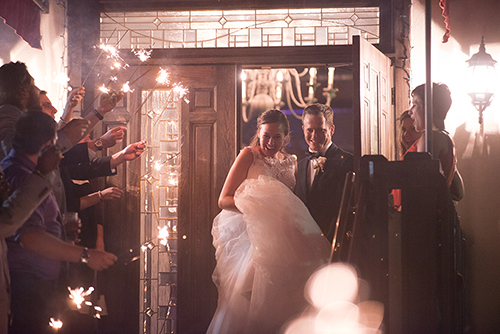 Photography of Bride and Groom leaving the wedding reception wit